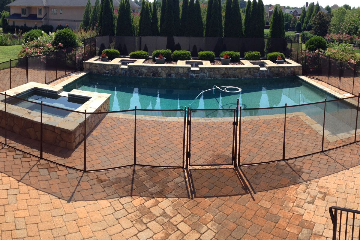 secure pool fence in pavers with self closing gate - Pool Fence Installation